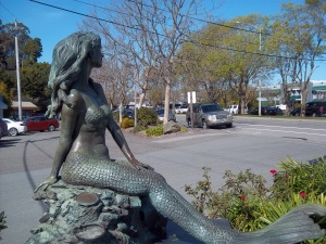Local mermaid, hidden behind a Shell sign.