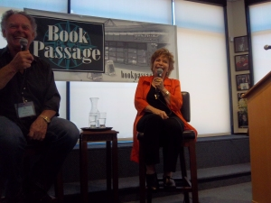 Doug Lyle and Isabel Allende speaking at conference participants.